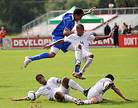 Jordan McCrary (4) of the USA and Brian Span (13) of the Academy Select Team fly through the air after an attempted tackle by Shaquille Phillips (6) and Jonathan Canales (5) of the USA. The US U-17 Men's National Team defeated the Development Academy Select Team 3-1 during day one of the US Soccer Development Academy  Spring Showcase in Sarasota, FL, on May 22, 2009.