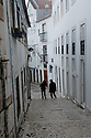 Lisbon, Portugal. 15.04.2016. Typical, narrow, Alfama street. Alfama is one of the oldest districts in Lisbon and dates back to the time of the Moorish domination. Photograph © Jane Hobson.