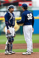 Brett Burch (20) of the Oral Roberts Golden Eagles stands on the mound with Tyler Sparks (32) during a game against the Missouri State Bears on March 27, 2011 at Hammons Field in Springfield, Missouri.  Photo By David Welker/Four Seam Images
