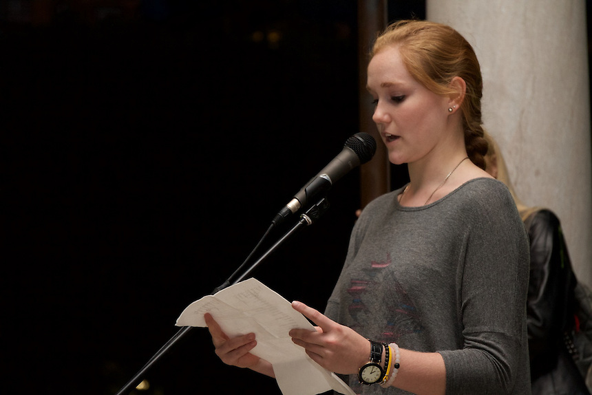 Alexandra Howard '17 reads a poem from someone who lost their life on 9/11 during Emerson's 9/11 Vigil.