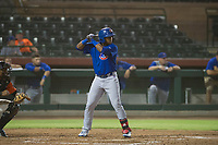AZL Cubs left fielder Nelson Velazquez (20) at bat in a dust storm during Game Three of the Arizona League Championship Series against the AZL Giants on September 7, 2017 at Scottsdale Stadium in Scottsdale, Arizona. AZL Cubs defeated the AZL Giants 13-3 to win the series two games to one. (Zachary Lucy/Four Seam Images)