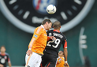 Houston Dynamo defender Bobby Boswell (32) heads the ball against D.C. United forward Maicon Santos (29) D.C. United tied The Houston Dynamo 1-1 but lost in the overall score 4-2 in the second leg of the Eastern Conference Championship at RFK Stadium, Sunday November 18, 2012.