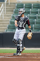 Kannapolis Intimidators catcher Brett Austin (10) makes a throw to second base between innings of the game against the Charleston RiverDogs at CMC-NorthEast Stadium on June 27, 2014 in Kannapolis, North Carolina.  The Intimidators defeated the RiverDogs 6-5.  (Brian Westerholt/Four Seam Images)