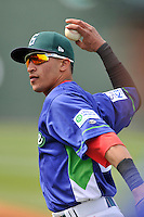 Shortstop Jeremy Rivera (35) of the Greenville Drive warms up before a game against the Asheville Tourists on Sunday, April 10, 2016, at Fluor Field at the West End in Greenville, South Carolina. Greenville won 7-4. (Tom Priddy/Four Seam Images)