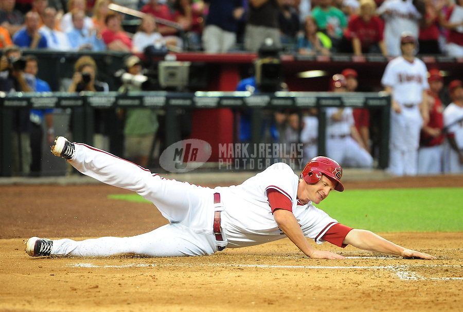 Apr. 23, 2012; Phoenix, AZ, USA; Arizona Diamondbacks base runner Lyle Overbay on the ground after being tagged out by Philadelphia Phillies catcher Carlos Ruiz (not pictured) in the first inning at Chase Field. Mandatory Credit: Mark J. Rebilas-
