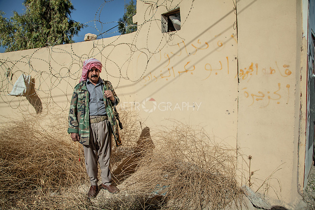 13/11/2015 -- Iraq,Sinjar -- A portrait of one of the volunteer fighters in front of the PDK main base, that base was used by ISIS for military purpose in the past.