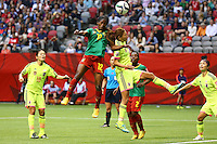 June 12, 2015: Claudine MEFFOMETOU TCHENO of Cameroon heads the ball during a Group C match at the FIFA Women's World Cup Canada 2015 between Cameroon and Japan at BC Place Stadium on 12 June 2015 in Vancouver, Canada. Japan won 2-1. Sydney Low/AsteriskImages