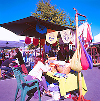 Artisan selling Clothing and Wares at the Saturday Market in Ganges, on Saltspring Island, in the Southern Gulf Islands of British Columbia, Canada