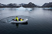 Launching dinghy from sailboat in iceberg filled water of Kong Oscars Havn, Tasiilaq, Greenland
