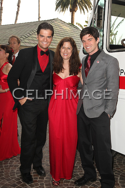 "BEN DECKER, MARCIA CALDIROLA, JORDAN JOHNSON. Red carpet arrivals to the annual ""Red Tie Affair,"" benefitting the American Red Cross of Santa Monica, and honoring the humanitarian spirit of those who have shown courage, unselfish character and whose work has saved lives. At the Fairmont Miramar. Santa Monica, CA, USA. April 17, 2010."
