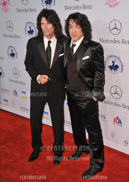 KISS stars Tommy Thayer (left) & Paul Stanley at the 26th Carousel of Hope Gala at the Beverly Hilton Hotel..October 20, 2012  Beverly Hills, CA.Picture: Paul Smith / Featureflash