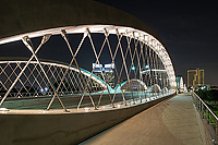 We capture this of the Seventh Street bridge in Fort Worth Texas at night as the lights of the city came on. Fort Worth recently added this modern architecture urban bridge which connects the university area of the city with the downtown area. The bridge crosses over the Trinity river in downtown.  The close up view of the bridge framed the the cityscape at night very nicely. Fort Worth is the fifth largest city in Texas and it is growing quickly.  In the past the city was known as a cow town because it was once part of the Chisholm trail cattle drives and had a rough tough brawling wild west place.  It still imbraces it western heritage but has grown to become a more modern city.
