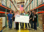 Jersey Central Power & Light Employees present a check for $6,528.00 to The Food Bank of Monmouth & Ocean in Neptune, NJ on April 13, 2017. (L to R) William Puchik, Kathleen Moore, Food Bank Director of Development Linda Keenan, John Mahon, Kieran Tintle, Courtney Donaldson, Melissa Todero, William Kwasnicki & Toni Reaves.