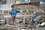 A boy walks amid rubble in Tacloban, a city in the Philippines province of Leyte that was hit hard by Typhoon Haiyan in November 2013. The storm was known locally as Yolanda. The ACT Alliance has been active here and in affected communities throughout the region helping survivors to rebuild their homes and recover their livelihoods.