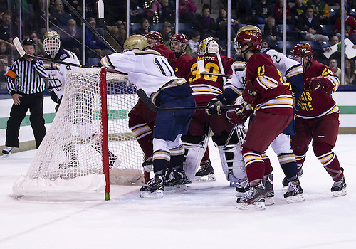 January 25, 2013:  Players skirmish in front of the net during NCAA Hockey game action between the Notre Dame Fighting Irish and the Ferris State Bulldogs at Compton Family Ice Arena in South Bend, Indiana.  Ferris State defeated Notre Dame 3-1.