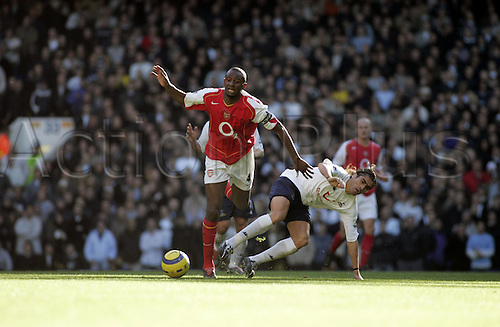 13 November 2004: Arsenal midfielder and captain Patrick Vieira is tackled by Pedro Mendes of Spurs during the Premiership match between Tottenham Hotspur and Arsenal. Arsenal won the game played at White Hart Lane 5-4. Photo: Action Plus..041113 soccer football premier league premiership player players footballer footballers