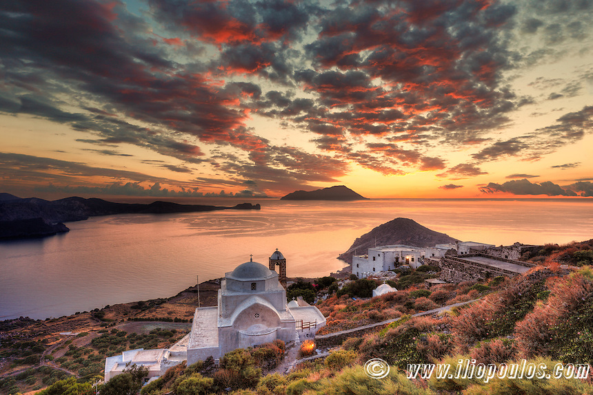 The sunset from the castle above the village of Plaka in Milos, Greece. Below the church of The Assumption of the Virgin Mary or Panaghia Skiniotissa and the church of Panaghia Thalassitra.