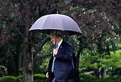 United States President Donald J. Trump walks towards Marine One prior to departing the White House to visit first lady Melania Trump at  Walter Reed National Military Medical Center, May 16, 2018, in Washington, DC. <br /> Credit: Olivier Douliery / Pool via CNP