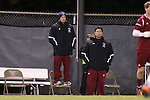 25 November 2012: FDU head coach Seth Roland (left) stands on a chair to getter a better view of the game with assistant coach Alex Passucci. The University of North Carolina Tar Heels played the Farleigh Dickinson Knights at Fetzer Field in Chapel Hill, North Carolina in a 2012 NCAA Division I Men's Soccer Tournament third round game. UNC won the game 1-0 in overtime.