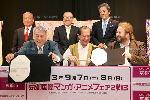 "April 24, 2013, Tokyo, Japan - (L to R) The organizer of KYOMAF Takayuki Mastutani, the Mayor of Kyoto Daisaku Kadokawa and the represent of Japan EXPO (in France) Thomas Sirdey show the documents of collaboration in the press conference of ""Kyoto international Manga Anime Fair 2013"" at Kabukiza Tower in Tokyo. In the press conference the organizers of KYOMAF, Mayor of Kyoto and Japan EXPO (in France) signed a document to collaborate together to promote the anime and manga culture in Europe and United States. The KYOMAF is the largest manga/anime fair in West Japan and will be free entrance for elementary school students and foreigners with passport. It will be held from September 6 to 8 at Miyako Messe, Kyoto. (Photo by Rodrigo Reyes Marin/AFLO).."