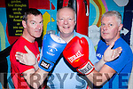 Gerard Murphy steps in between Jerome Hartnett and Edmond Hartnett as they prepare for their fight in the Castleisland Desmonds Brawl in the Hall