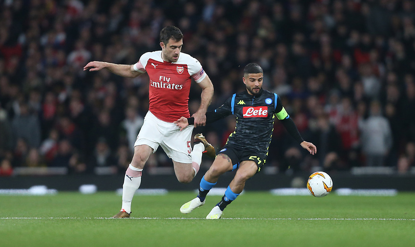 Arsenal's Sokratis Papastathopoulos and Napoli's Lorenzo Insigne<br /> <br /> Photographer Rob Newell/CameraSport<br /> <br /> UEFA Europa League First Leg - Arsenal v Napoli - Thursday 11th April 2019 - The Emirates - London<br />  <br /> World Copyright © 2018 CameraSport. All rights reserved. 43 Linden Ave. Countesthorpe. Leicester. England. LE8 5PG - Tel: +44 (0) 116 277 4147 - admin@camerasport.com - www.camerasport.com