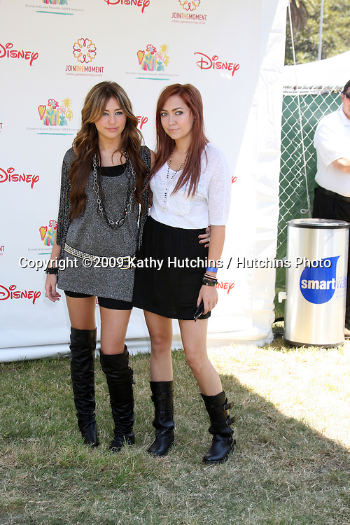 """Miley Cyrus & Sister Brandi Cyrus arriving at the """"A Time For Heroes Celebrity Carnival"""" benefiting the Elizabeth Glaser Pediatrics AIDS Foundation at the Wadsworth Theater Grounds in Westwood , CA on June 7, 2009 .©2009 Kathy Hutchins / Hutchins Photo.."""