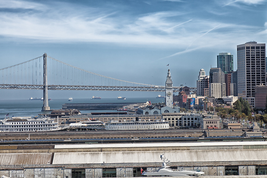 A view across the port area of the Ferry Building tower and Bay Bridge in San Francisco.