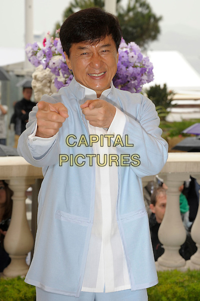 Jackie Chan.'Chinese Zodiac' photocall at the 65th  Cannes Film Festival, France..17th May 2012.half length white shirt blue suit hands finger spointing.CAP/PL.©Phil Loftus/Capital Pictures.