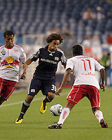New England Revolution defender Kevin Alston (30) takes on New York Red Bulls midfielder Danleigh Borman (11). The New England Revolution defeated the New York Red Bulls, 3-2, at Gillette Stadium on May 29, 2010.