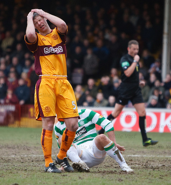 Stephen Craigan is distraught after a bobble on the pitch leads to Celtic's goal