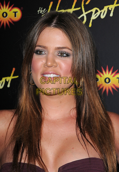 KHLOE KARDASHIAN.GameSpot HotSpot Party held at Goa in Hollywood, California, USA. .July 15th, 2008                                                                     headshot portrait gold hoop earrings chloe .CAP/DVS.©Debbie VanStory/Capital Pictures.