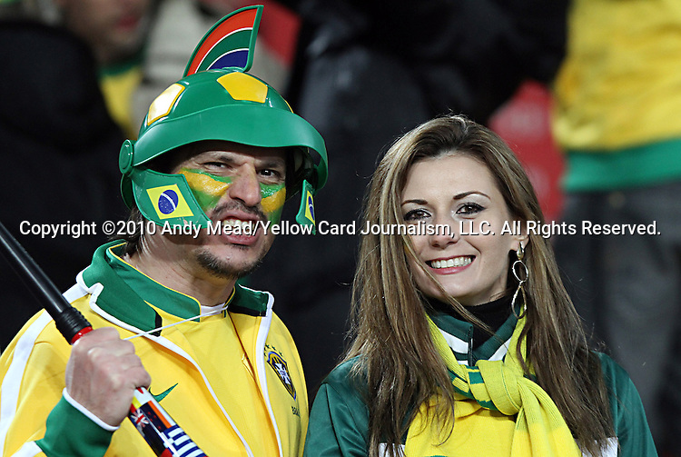 15 JUN 2010:  Brazil fans with a vuvusela in the stands.  The Brazil National Team played the North Korea National Team at Ellis Park Stadium in Johannesburg, South Africa in a 2010 FIFA World Cup Group G match.