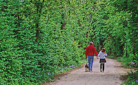 419-58 Dad and daughter hiking along I&M Canal Hiking Trail, between Chanahon State Park and McKinley Woods Forest Preserve in Will County, Illinois