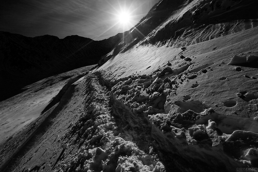 The tracks of numerous boots and snowshoes cut across the lower slopes of Mount Kelso, in Stevens Gulch near Grays and Torreys peaks, Colorado.