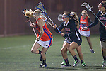 Santa Barbara, CA 02/18/12 - Christina Monahan (Florida #5) and Lauren Mah (Chapman #2) and Delaine De Beers (Chapman #21) in action during the Chapman - Florida matchup at the 2012 Santa Barbara Shootout.  Florida defeated Chapman 12-11.