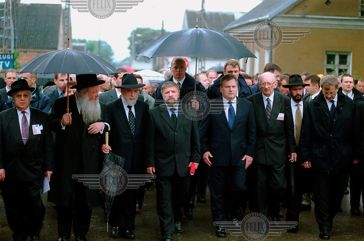 Officials head for the Jedwabne pogrom commemoration ceremony. From left: Shevah Weiss, Israeli ambassador (with red roll in hand), Aleksander Kwasniewski, Polish president, Wladyslaw Bartoszewski (Polish politician, social activist, journalist, writer, historian, Auschwitz concentration camp inmate), in the streets of Jedwabne.
