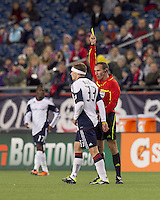 New England Revolution midfielder Zak Boggs (33) gets a yellow card. In a Major League Soccer (MLS) match, the New England Revolution tied the Portland Timbers, 1-1, at Gillette Stadium on April 2, 2011.