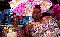 ELMONT, NY - JUNE 10: Two fans smile for the camera while holding a princess umbrella on Belmont Stakes Day at Belmont Park on June 10, 2017 in Elmont, New York (Photo by Scott Serio/Eclipse Sportswire/Getty Images)