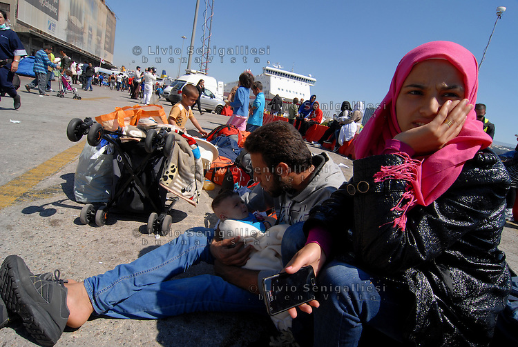 Pireus / Athens 31/3/2016<br /> Syrian refugees forced by local authorities to leave Pireus camp after night clashes against groups of afghani refugees. Syrian families with children have been taken in other refugee camps near Albania border.<br /> Photo Livio Senigalliesi