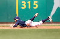 Cedar Rapids Kernels shortstop Jorge Polanco #5 makes a diving stop during a game against the Lansing Lugnuts at Veterans Memorial Stadium on April 30, 2013 in Cedar Rapids, Iowa. (Brace Hemmelgarn/Four Seam Images)