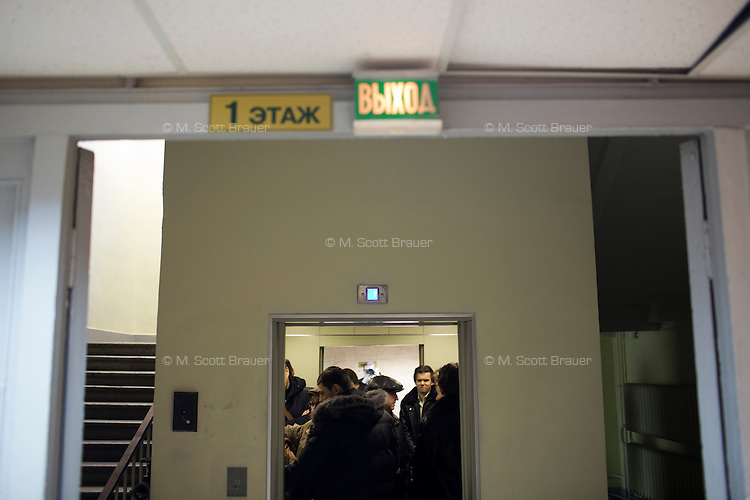 People wait in an elevator in the offices of Moskovskii Komsomolets in Moscow, Russia.