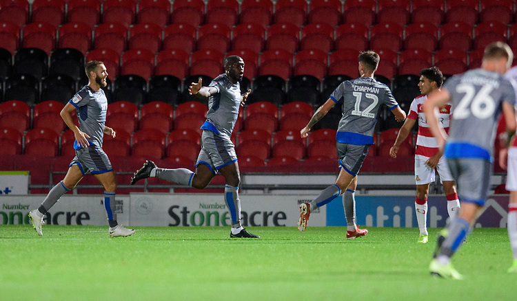 Lincoln City's John Akinde, centre, celebrates scoring the opening goal<br /> <br /> Photographer Chris Vaughan/CameraSport<br /> <br /> EFL Leasing.com Trophy - Northern Section - Group H - Doncaster Rovers v Lincoln City - Tuesday 3rd September 2019 - Keepmoat Stadium - Doncaster<br />  <br /> World Copyright © 2018 CameraSport. All rights reserved. 43 Linden Ave. Countesthorpe. Leicester. England. LE8 5PG - Tel: +44 (0) 116 277 4147 - admin@camerasport.com - www.camerasport.com