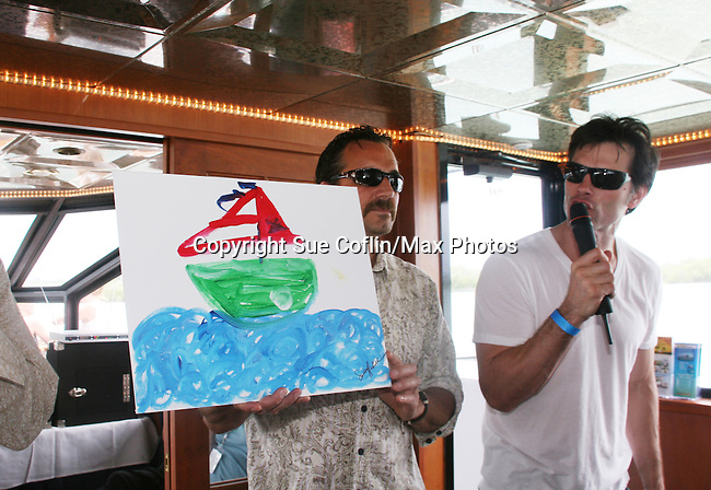 Thorsten Kaye auctioning painting on the 12th Annual SoapFest - Cruisin' & Schmoozin' on the Marco Island Princess to raise dollars to benefit Marco Island YMCA, theatre program & Art League of Marco Island on May 16, 2010 on Marco Island, FLA. (Photo by Sue Coflin/Max Photos)
