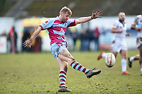 Caolan Ryan of Rotherham Titans puts boot to ball. Greene King IPA Championship match, between Rotherham Titans and Bedford Blues on January 17, 2018 at Clifton Lane in Rotherham, England. Photo by: Patrick Khachfe / Onside Images