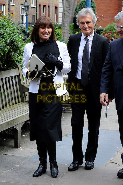 STEPHANIE BEACHAM.Dynasty star, Christopher Cazenove's funeral at St. Paul's Church in Covent Garden, London, England..April 16th, 2010.full length mourners black white skirt jacket top glasses .CAP/IA.©Ian Allis/Capital Pictures.