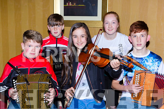 Luke Ryan, Jack, Eabha, Marie and Joe Rudden playing some yunes at the Workmens RC Ceili in the Killarney Avenue Hotel on Saturday night