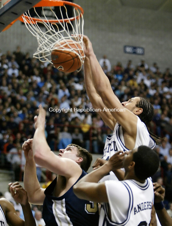 STORRS, CT--31 JANUARY 2006- 013106JS06-<br /> UConn's Josh Boone slams in a put-back miss by Rudy Gay over Pittsburgh Aaron Gray during their 80-76 win Monday at Gampel Pavilion in Storrs.<br />  --Jim Shannon Republican American--UConn; Pittsburgh, are CQ