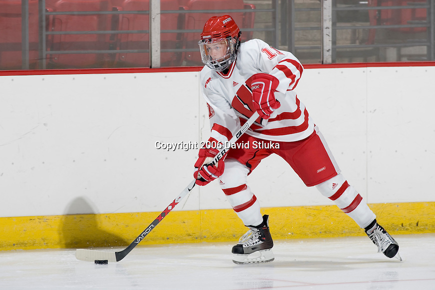 MADISON, WI - SEPTEMBER 29: Kyla Sanders #11 of the Wisconsin Badgers women's hockey team skates during warmups prior to the game against the Quinnipiac Bobcats at the Kohl Center on September 29, 2006 in Madison, Wisconsin. The Badgers beat the Bobcats 3-0. (Photo by David Stluka)