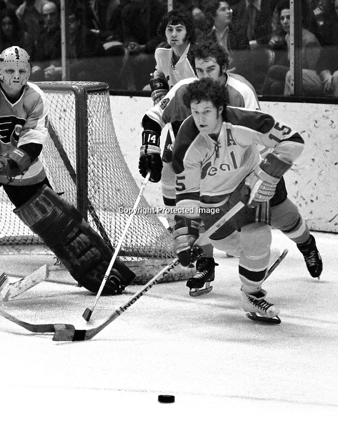Seals Gerry Pinder after puck Flyer goalie is Doug Favell, behind him is Flyer Joe Watson. Photo/Ron Riesterer